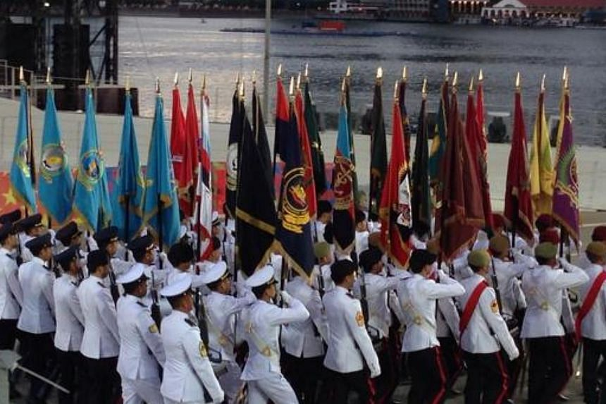 The State Colours blazing the trail for the march past. -- ST PHOTO: YEO SAM JO