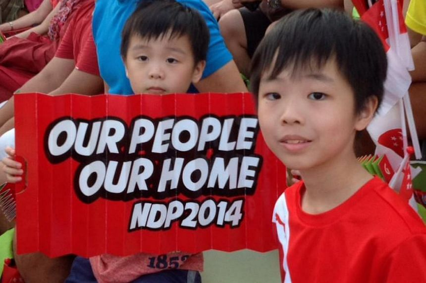 Spectators decked in red and white filled the stands, as this year's National Day Parade got off to a roaring start. -- PHOTO: GRACE TAN