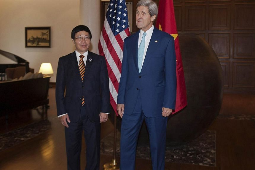 US Secretary of State John Kerry (right) meets with Vietnam's Foreign Minister Pham Binh Minh at the Lake Garden hotel outside the venue of the 47th Asean Foreign Ministers' Meeting in Naypyidaw on Aug 9, 2014.Mr Kerry kicked off a South-east A