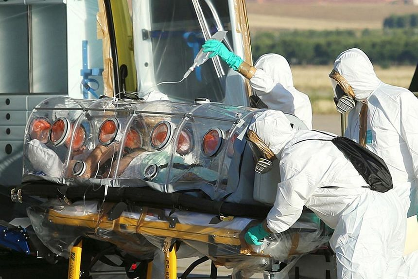A handout picture taken and released on August 7, 2014 by the Spanish Defense Ministry shows Roman Catholic priest Miguel Pajares, who contracted the deadly Ebola virus, being transported from Madrid's Torrejon air base to the Carlos III hospital upo