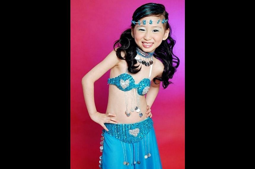 Evette Tan (above) when she was eight years old, a year after she started learning belly dancing from her entrepreneur mother.