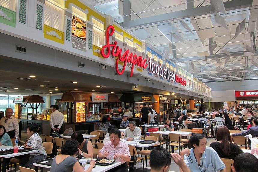Eight of the stalls at the Singapore Food Street in Changi Airport (left) have been renamed, including Fatimah Nasi Lemak (above).