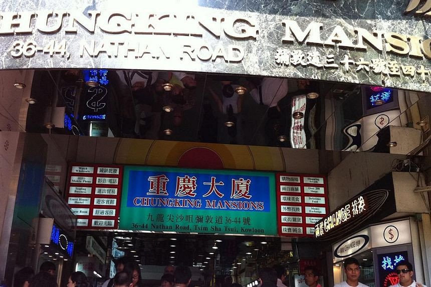 Chungking Mansions in Hong Kong's Tsim Sha Tsui.The Nigerian man suspected of having Ebola had been staying at a guesthouse in Chungking Mansions, reported the Xinhua news agency. -- PHOTO: ST FILE