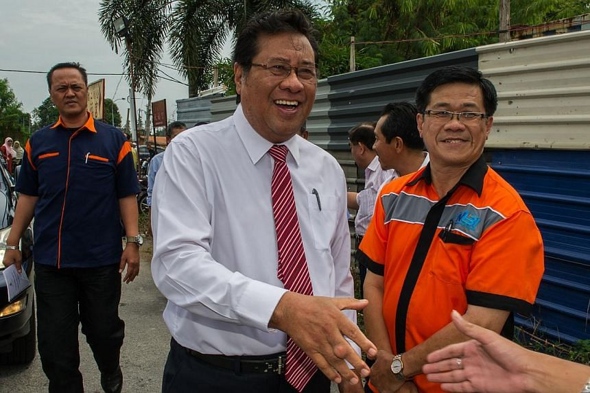 Chief Minister of Selangor Abdul Khalid Ibrahim (centre) attending a ceremony to launch the third bridge project in Klang, outside Kuala Lumpur on August 6, 2014. A power-broking rift within Malaysia's opposition alliance is spurring fears that the u