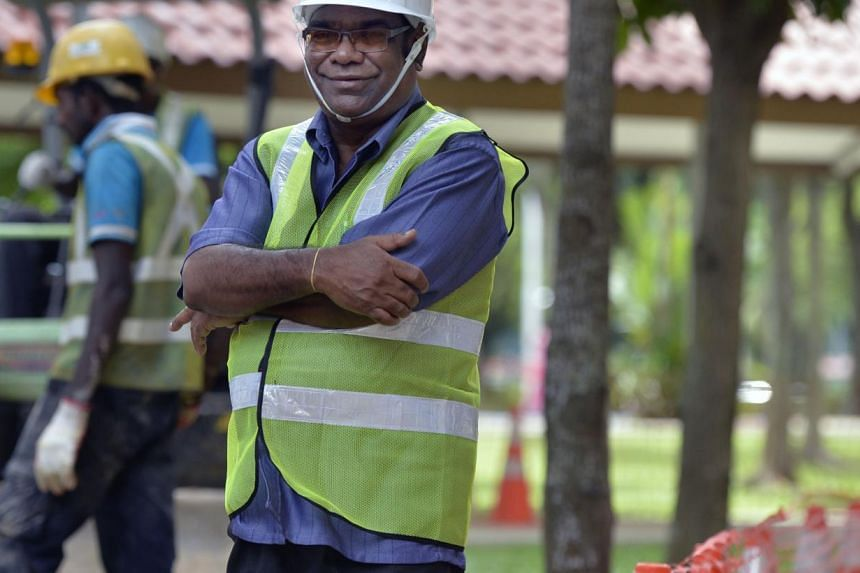 PUB has introduced a new policy to offer 65-year-old employees like technical officer Danabal Kahsairajah re-employment until 67 years old. The agency had previously offered such re-employment on a case by case basis. -- PHOTO: ST FILE