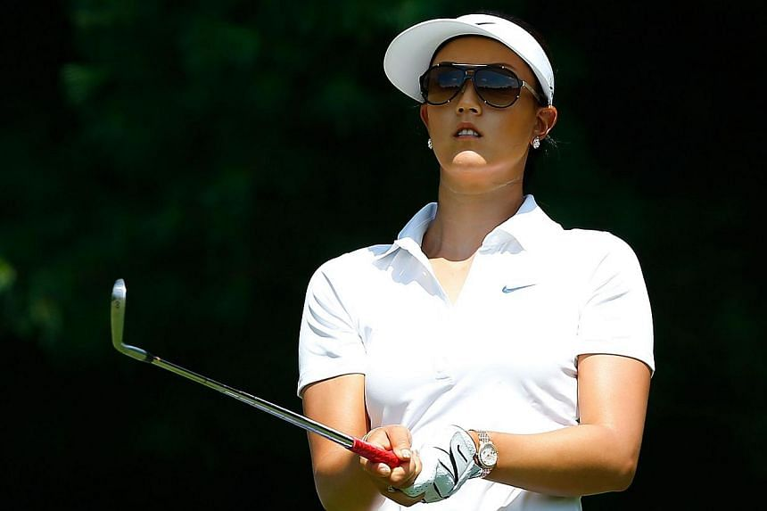 Michelle Wie watches her tee shot on the third hole during the first round of the Meijer LPGA Classic at Blythefield Country Club on Aug 7, 2014, in Belmont, Michigan.American golfer Michelle Wie could miss up to five weeks of the LPGA Tour aft