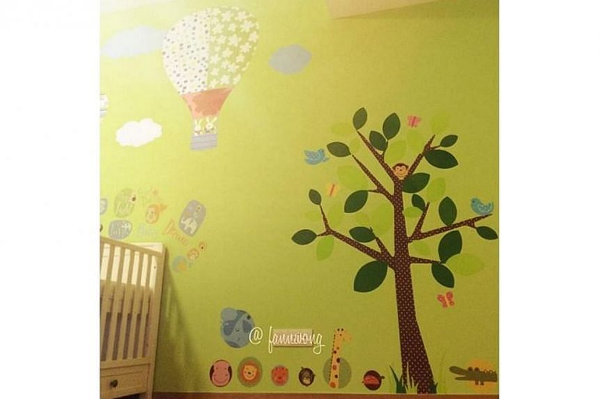 Dad Christopher Lee designed Zed's room, which has been painted green and white with large wall stickers of a hot-air balloon, tree and forest animals. -- PHOTO: FANN WONG/INSTAGRAM