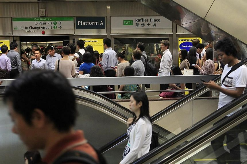 Raffles Place MRT is one of three stations where commuters will get to enjoy free Wi-Fi access at platform level from August 22. -- PHOTO: ST FILE