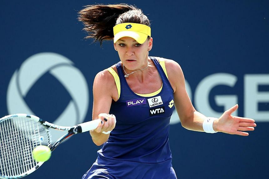 Third seed Agnieszka Radwanska of Poland returns a shot to Venus Williams of the US during the women's final of theRogers Cup in Montreal, Canada,on August 10, 2014, setting herself up as a player to watch at the upcoming US Open. -- PHOT