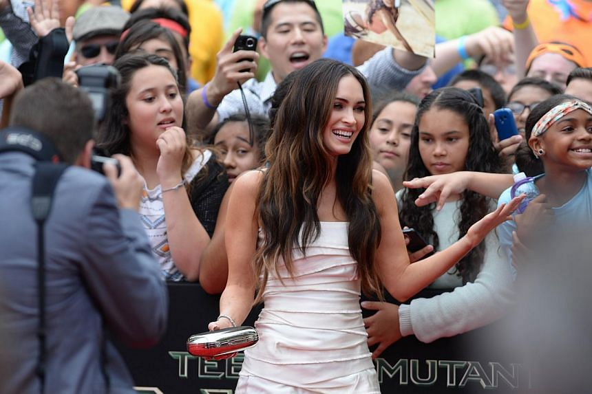 Cast member Megan Fox attends the premiere of Teenage Mutant Ninja Turtles on August 3, 2014 at the Regency Village Theatre in Los Angeles. The movie earned US$65 million (S$81 million) in ticket sales at US and Canadian movie theatres over the