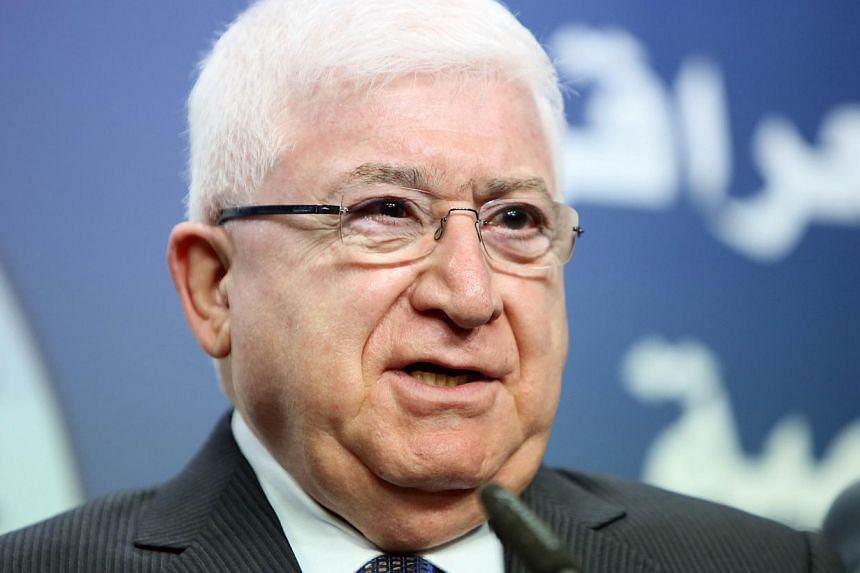 The United States threw its weight behind Iraqi President Fuad Masum on Sunday after Prime Minister Nuri al-Maliki announced on state television he would be filing a complaint against Masum, as security forces massed in the capital. -- PHOTO: AFP