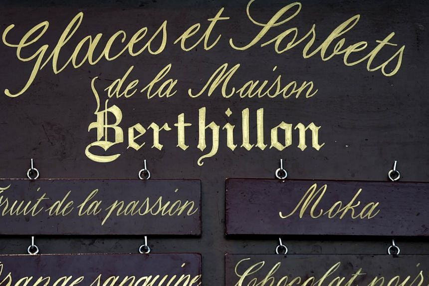 A photo taken on August 11, 2014 shows a board displaying different flavours of Berthillon ice cream on a bar of the Ile-Saint-Louis in Paris. Raymond Berthillon, founder of the Berthillon ice cream shop on Paris's iconic Ile Saint-Louis considered b