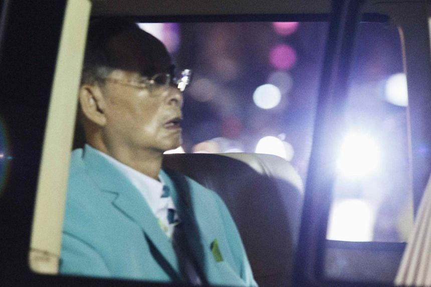 Thailand's King Bhumibol Adulyadej arrives in a van at Siriraj hospital in Bangkok August 6, 2014. The palace on August 11, 2014 said the 86-year-old monarch is in good overall health, with doctors administering medicine to tackle stomach infla