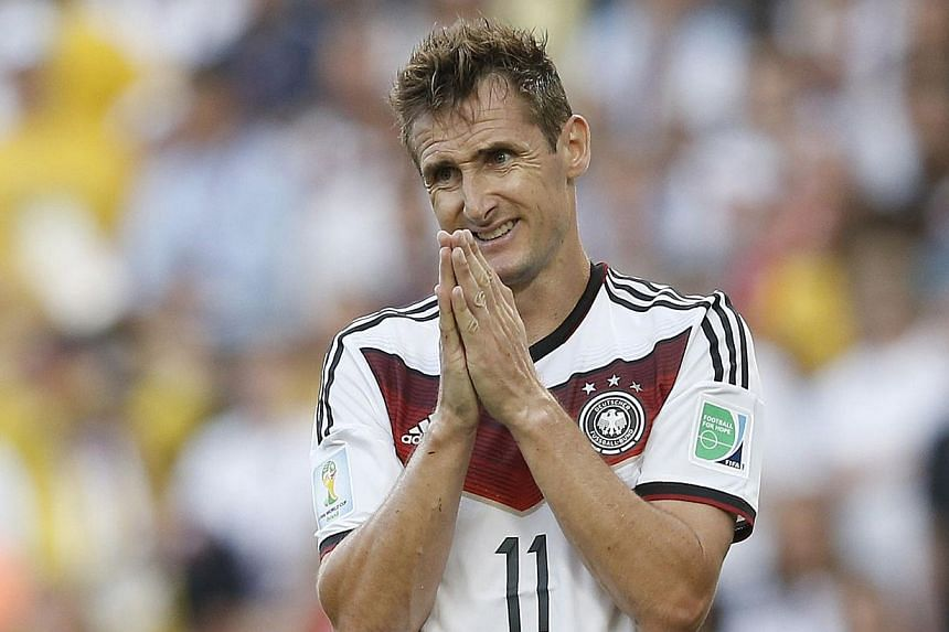 A photo taken on July 13, 2014 shows Germany's forward Miroslav Klose reacting during the 2014 FIFA World Cup final football match between Germany and Argentina at the Maracana Stadium in Rio de Janeiro . Klose, the all-time World Cup top scorer, has