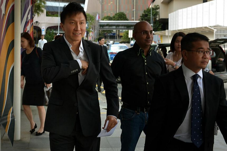 Kong Hee (right) arriving at the State Courts on Aug 11, 2014. -- ST PHOTO: KUA CHEE SIONG