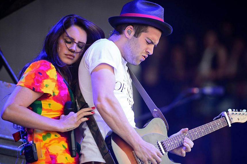 US singer Lana Del Rey interacts with her guitarist as she performs at Britain's Glastonbury Festival on June 28, 2014. Del Ray is the latest Western musician to call off a concert in Israel as security fears from the Gaza conflict take a toll o