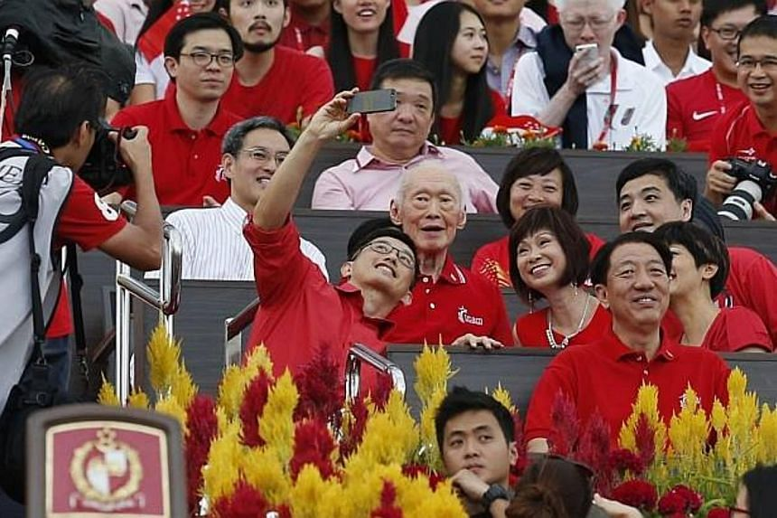 Mr Teo Ser Luck, Minister of State at the Ministry of Trade and Industry, taking a selfie at the National Day Parade 2014. SOURCE: KEVIN LIM