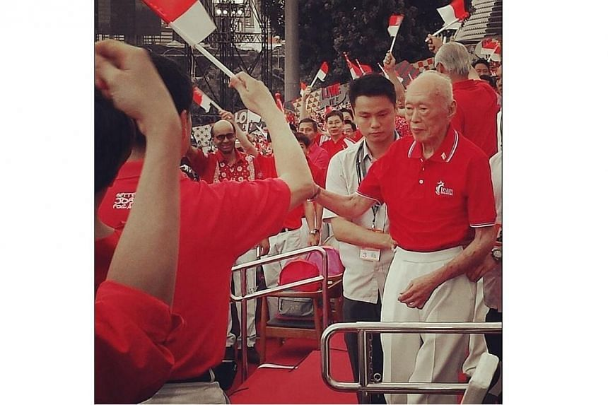 "Former Prime Minister Lee Kuan Yew at the National Day Parade 2014. This photo, taken by Tampines GRC MP Baey Yam Keng was captioned: ""Everyone happy to see our founding PM at NDP."" SOURCE: BAEY YAM KENG"