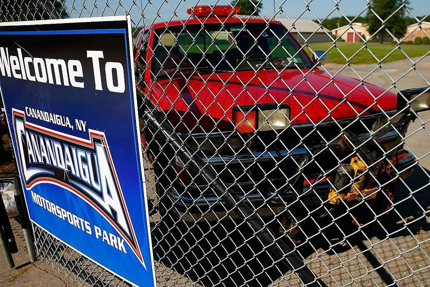 A vehicle sits parked at the side entrance of the Canandaigua Motorsports Park on August 10, 2014 in Canandaigua, New York. NASCAR Sprint Cup driver Tony Stewart hit and killed sprint car driver Kevin Ward Jr during a dirt track race at Canandaigua o