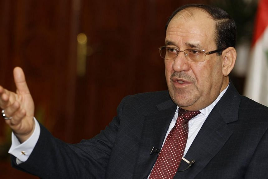 Iraqi Prime Minister Nouri al-Maliki indicated that he will not drop his bid for a third term and accused the president of violating the constitution in a tough televised speech likely to deepen political tensions as a Sunni insurgency rages. -- PHOT