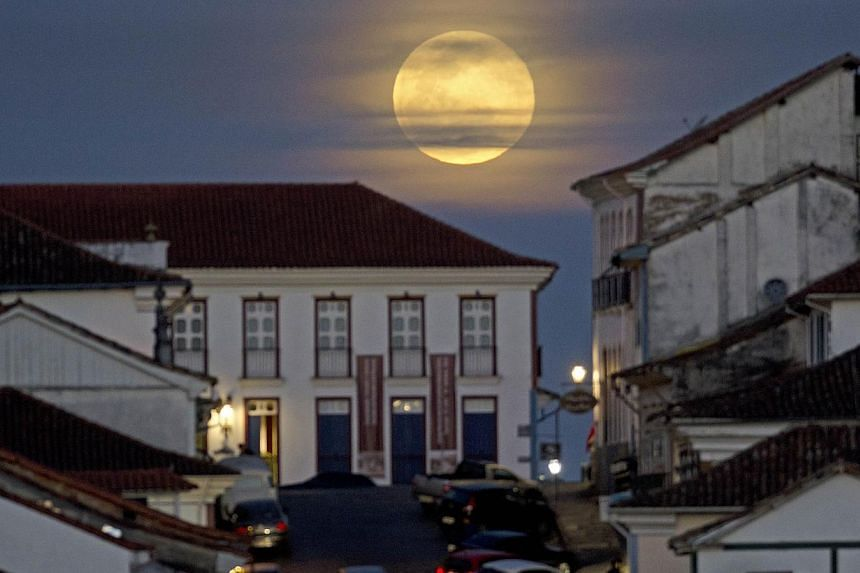 "View of the full moon nicknamed ""the supermoon"" in Ouro Preto, Brazil. -- PHOTO: AFP"