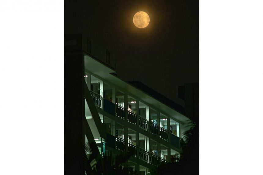"The full moon, also called the ""Supermoon"" or the Perigee-Syzygy of the Earth-Moon-Sun system, as seen in Singapore. -- PHOTO: ST FILE"