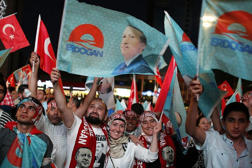 Supporters of Turkey's Prime Minister Tayyip Erdogan celebrate his victory in the presidential election in front of the party headquarters in Ankara August 10, 2014. He hasclimbed from a humble youth in Istanbul to become one of the most signif