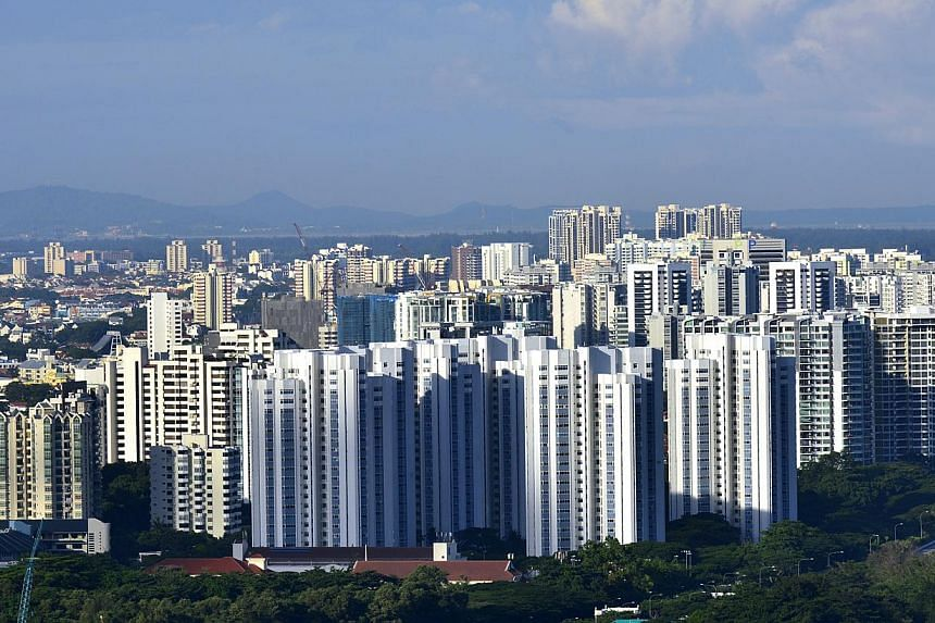 Resale prices for private homes continued their slide in July to reach their lowest level in 21 months, according to Singapore Real Estate Exchange (SRX) flash estimates released on Monday. -- ST PHOTO: CAROLINE CHIA