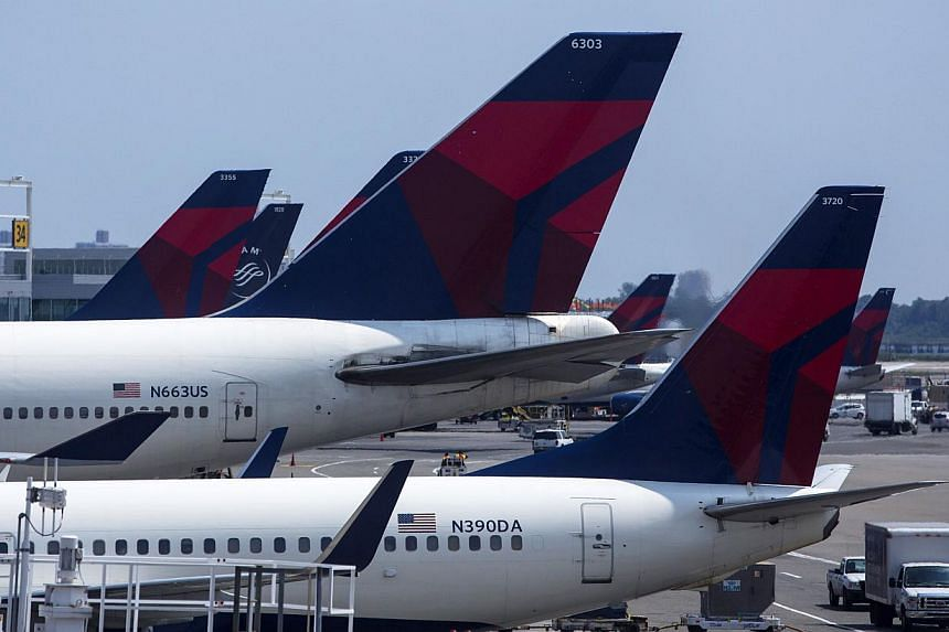 Delta Airlines planes sit at Terminal 4 at John F. Kennedy Airport July 22, 2014, in New York City. Beset by low air fares and relentless competition, airlines around the world are waking up to the value of their frequent flyer programmes (FFP)