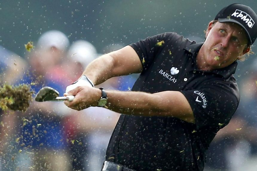 Phil Mickelson of the U.S. hits off a wet fourth fairway during the final round of the 2014 PGA Championship at Valhalla Golf Club in Louisville, Kentucky, on Aug 10, 2014.Phil Mickelson settled for second place to Rory McIlroy on Sunday at the
