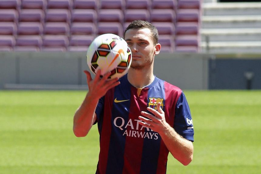 Belgium soccer player Thomas Vermaelen is pictured during his presentation at Nou Camp stadium in Barcelona, on Aug 10, 2014.Barcelona's new signing Thomas Vermaelen has an injured right hamstring and is not yet ready to start training, the Spa