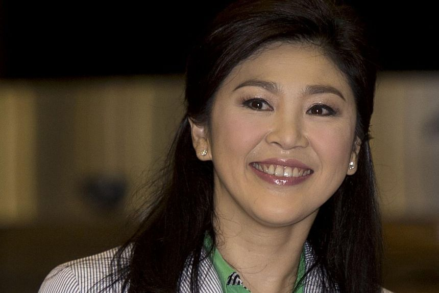 Thailand's deposed former prime minister Yingluck Shinawatra smiles as she arrives at Suvarnabhumi International airport in Bangkok on July 23, 2014.Former Thai Prime Minister Yingluck Shinawatra has returned home from a trip overseas, putting
