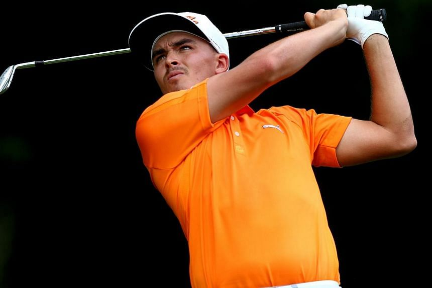 Rickie Fowler of the United States hits his tee shot on the third hole during the final round of the 96th PGA Championship at Valhalla Golf Clubin Louisville, Kentuckyon Aug 10, 2014. -- PHOTO: AFP