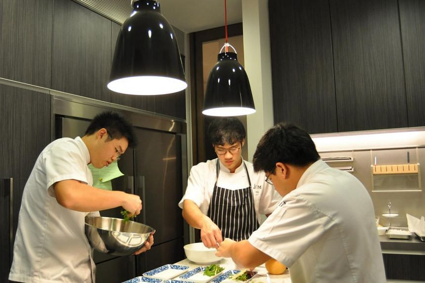 Amateur chefs (from left) Jeremy Cheok, Alroy Chan, and Ming Tan, cooking together. More and more men are taking to cooking in a sign of changing times. STPHOTO: TAN HUANG MING