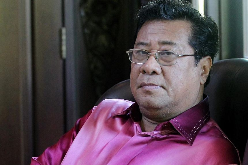 Tan Sri Khalid Ibrahim may be hanging on by a thread to the Selangor Mentri Besar's post, but he is not about to step down any time soon. -- PHOTO: THE STAR/ASIA NEWS NETWORK