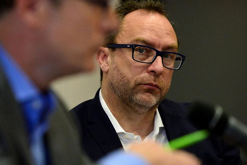 Jimmy Wales (right), co-founder of Wikipedia, attending a press conference in central London on August 6, 2014 ahead of the three-day Wikimaniaconference. -- PHOTO: AFP