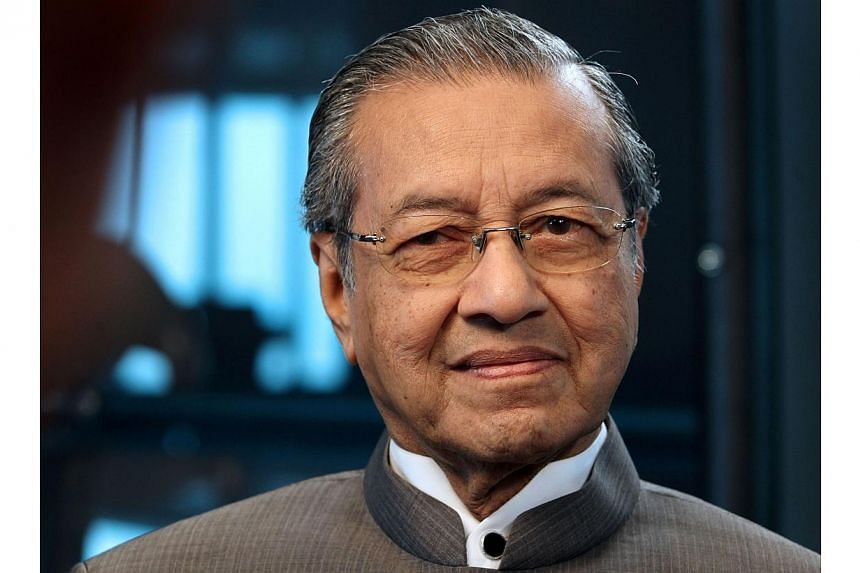 Influential Malaysian former prime minister Mahathir Mohamad on Tuesday, Aug 12, 2014, criticised the takeover of crisis-hit Malaysia Airlines by the country's sovereign wealth fund as a recipe for more losses by the carrier. -- PHOTO: BLOOMBERG