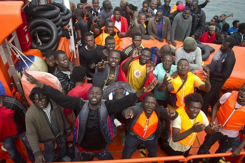 Would-be immigrants react as they arrive at Tarifa's harbour on Aug 11, 2014, after being rescued off the Spanish Coast.-- PHOTO: AFP