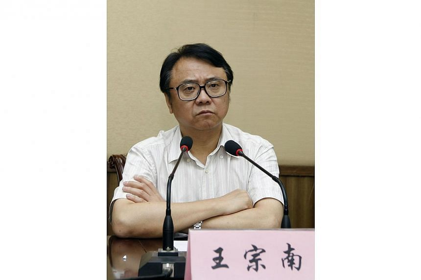 Businessman Wang Zongnan attending a meeting in Shanghai on July 30, 2012. Chinese prosecutors have ordered the arrest of Wang, the former chairman of state-owned Bright Food Group Co Ltd on suspicion of bribe-taking and embezzling public funds.