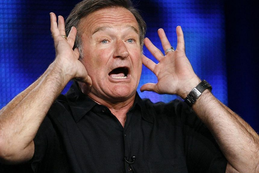 Robin Williams gestures during a panel discussion for his HBO show Robin Williams: Weapons of Self-Destruction at the Television Critics Association Cable summer press tour in Pasadena, California on July 30, 2009. -- PHOTO: REUTERS