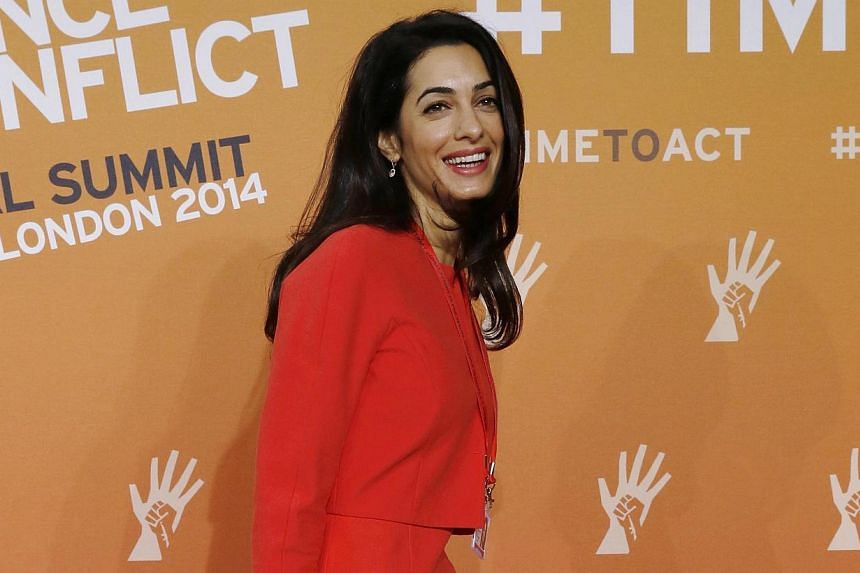 Barrister Amal Alamuddin, fiancee of actor George Clooney, attending a summit to end sexual violence in conflict at the Excel centre in London on June 12, 2014. The 36-year-old, who is fluent in Arabic, French and English, is one of three top ex