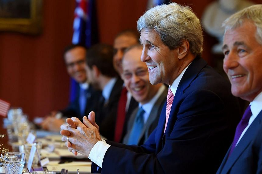 US Secretary of State John Kerry (second from right) and Secretary of Defence Chuck Hagel (right) take part in talks at Admiralty House in Sydney on August 12, 2014. -- PHOTO: AFP