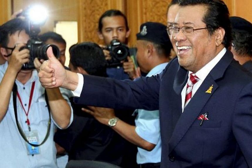 Man in charge: A confident Khalid is all smiles as he gives the thumbs up at his press conference in Shah Alam. -- PHOTO: THE STAR