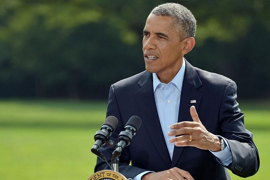 US President Barack Obama on Monday urged a quick political transition in Iraq in a rebuke to controversial prime minister Nuri al-Maliki. -- PHOTO: AFP