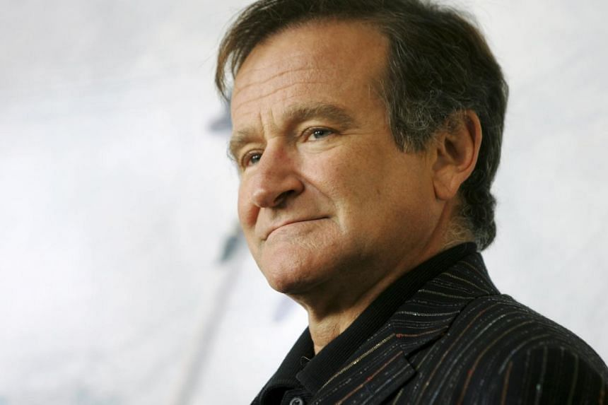 U.S. actor Robin Williams poses for photographers during a photocall in Rome in this file picture taken November 15, 2005. Oscar-winning actor and comedian Williams was found dead on Monday from an apparent suicide at his home in Northern California,
