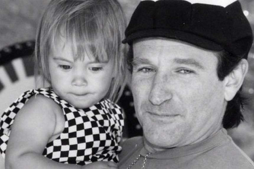 "Robin Williams with his daughter Zelda Rae Williams in a picture he posted on his Instagram account on July 31, 2014. He captioned the picture, ""#tbt and Happy Birthday to Ms. Zelda Rae Williams! Quarter of a century old today but always my baby girl"