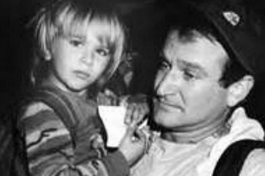 """Robin Williams with his son Zachary Pym in a picture he posted on his Instagram account on April 11, 2014. He captioned the picture, """"You're a grown man now and I'm so proud of you. A little bit of you will always be my """"Mr Pym"""". Happy Birthday"""