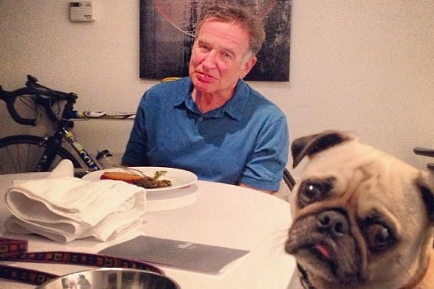 """Robin Williams with his dog leonard in a picture he posted on his Instagram account in 2013. He captioned the picture, """"Worth a repeat. My dinner with Leonard. Miss him when I'm on location."""" -- SCREENGRAB: INSTAGRAM/ ROBIN WILLIAMS"""