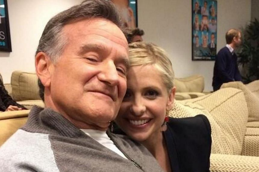 Robin Williams with Sarah Michelle Gellar, his co-star in TV series The Crazy Ones, in a picture he posted on his twitter account on Feb 28, 2014. -- PHOTO: TWITTER/ ROBIN WILLIAMS