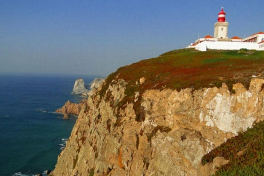 The Cabo da Roca lighthouse in Portugal. A Polish couple fell to their death while apparently trying to take selfies with their children on the edge of a cliff in Portugal's Cabo da Roca. Details of the incident are still unclear. -- PHOTO: TWITTER